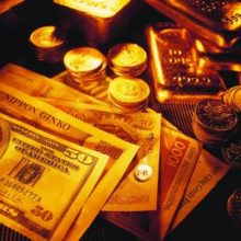 Золото дешевеет, доллар растет