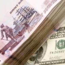 Рубль растет к бивалютной корзине