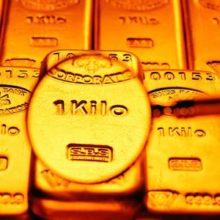 Золото растет на опасениях по поводу Ливии
