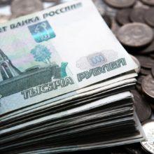 Курс рубля к доллару и евро приостановил снижение